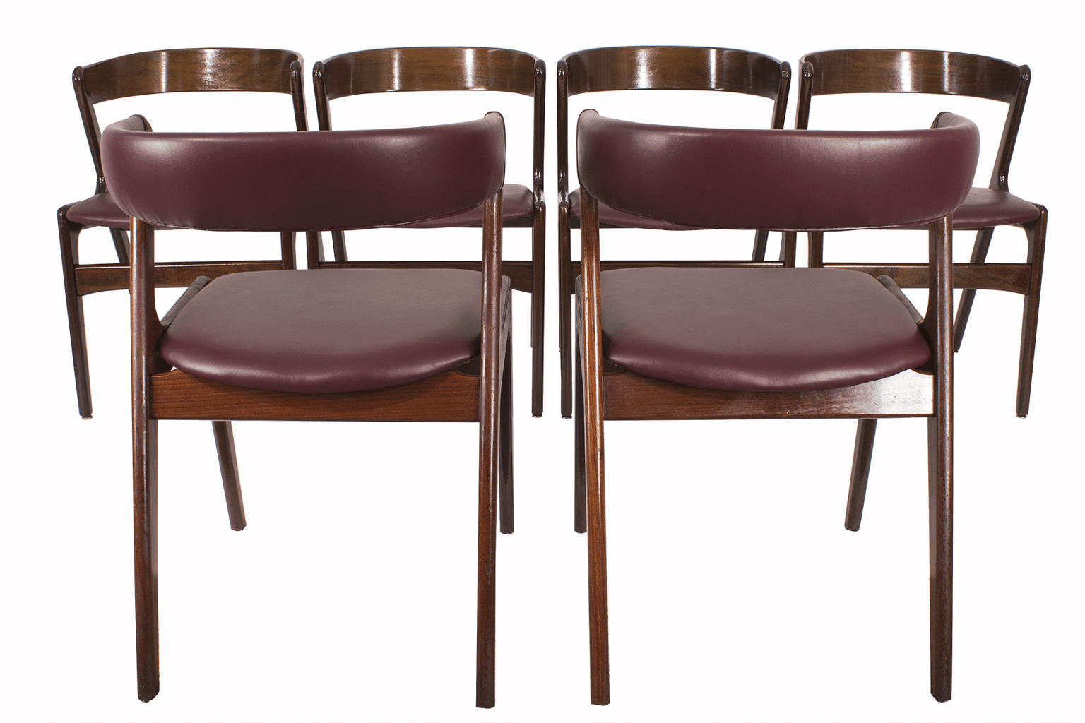 This set of Kai Kristiansen dining room chairs comprises two end chairs with upholstered backs and four side chairs with plain backs.