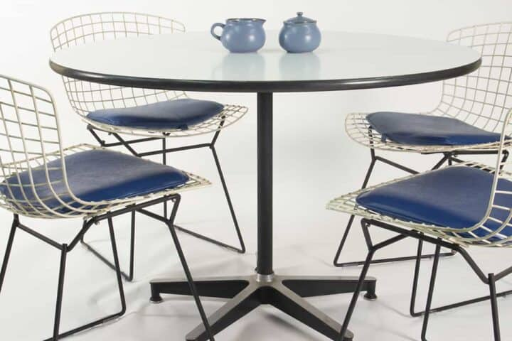 Herman Miller round table and 4 Bertoia side chairs by Knoll.