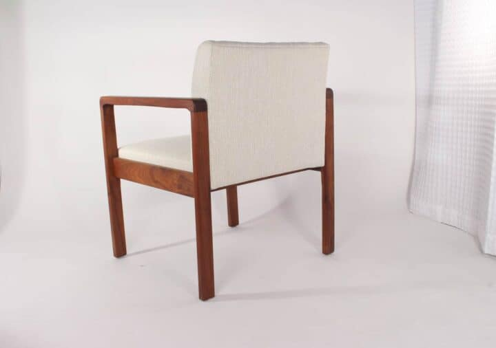 Pair of Danish teak frame lounge chairs with textured white upholstery.