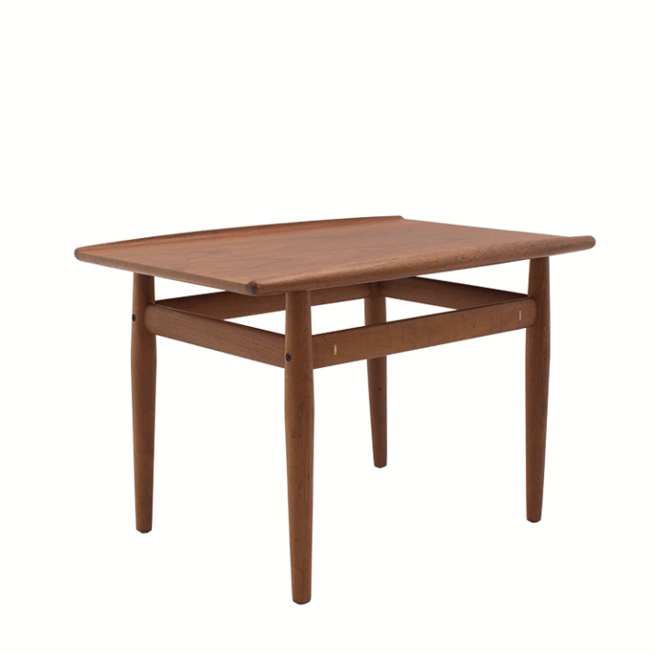 This Side Table by Greta Jalk has curled edges on the top and the clean lines that you look for in mid century modern and danish modern furniture design. Vintage original finish.